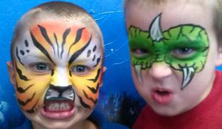 JoAnna Esposito Festival Face Painter in Tampa St Petersburg Florida CT USA tiger and dragon